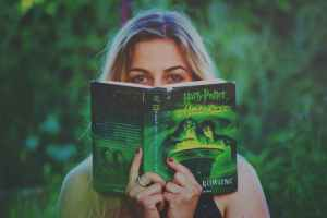 woman reading harry potter book