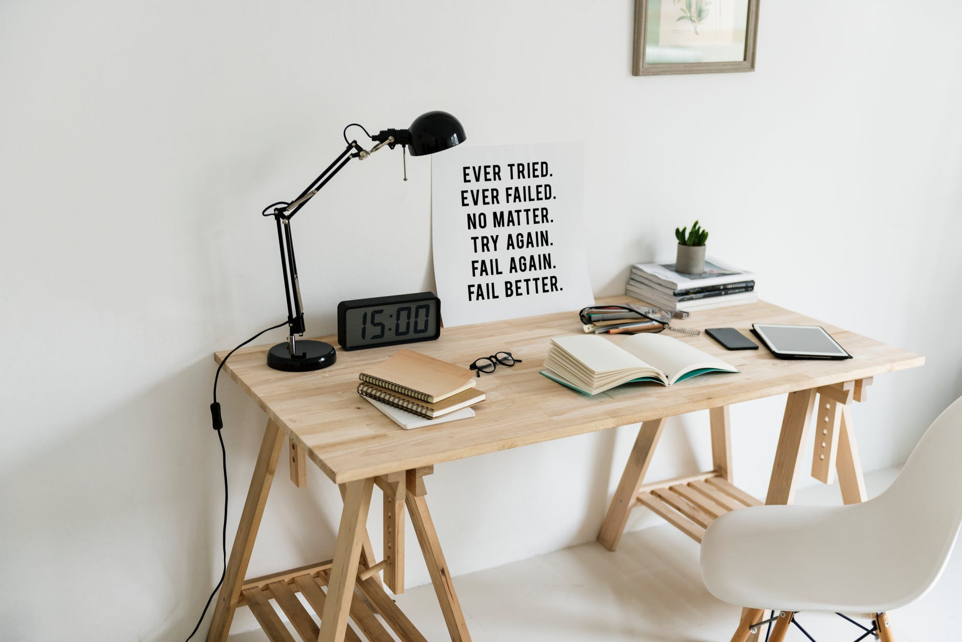 wooden desk with books on top