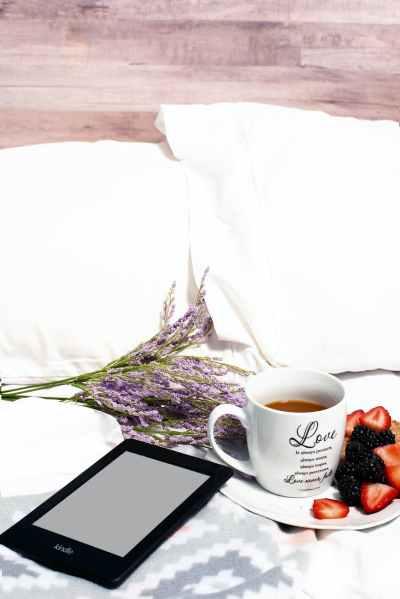 white ceramic mug on plate with strawberries